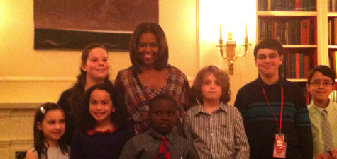 Michelle Obama poses with kid reporters